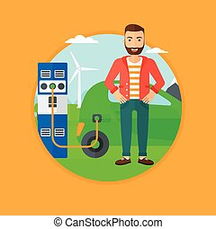 Charging of electric car - A hipster man with the beard...