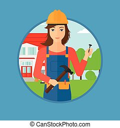 Cheerful builder with hammer. - A female builder in uniform...