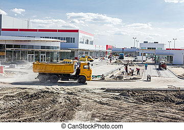 Landscape transform into urban area with machinery, people...