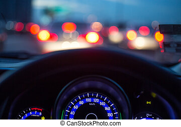 The car console waiting in a traffic jam at evening