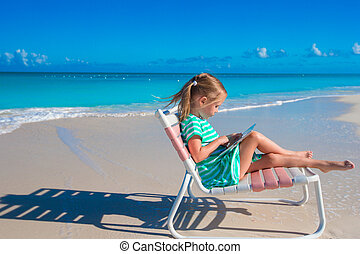 Adorable little girl with laptop outdoors - Little girl with...