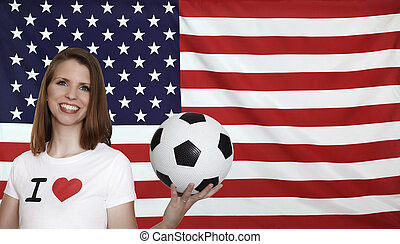 USA Flag with female soccer fan with flag in the background