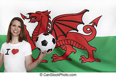 Wales Flag with female soccer fan with flag in the...