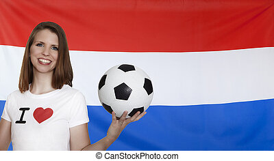 Netherlands Flag with female soccer fan with flag in the...
