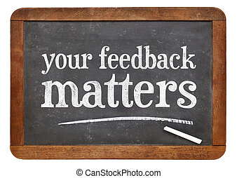 your feedback matters sign - white chalk text on a vintage...