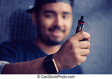 Young black man holding e-cig vaporizer - Portrait of young...