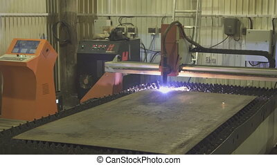 Running machine plasma cutting process workpiece on...