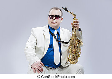Caucasian Saxophone Player Posing with Instrument In...