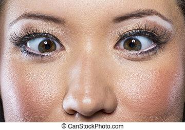 Cross-Eyed Model - A model crossing her eyes in a studio...