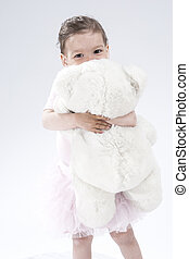 Little Caucasian Cute Female Child Posing with Toy Against...