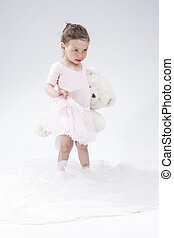 Portrait of Little Caucasian Cute Female Child Posing with...