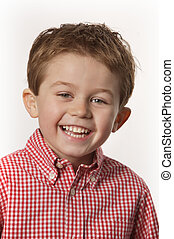 young boy smiling - cute young boy smiling with white...