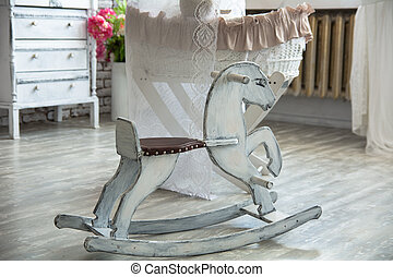 room in retro style with rocking horse