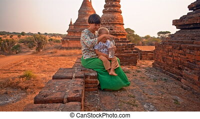 rest on the temple terrace - young woman with toddler son...