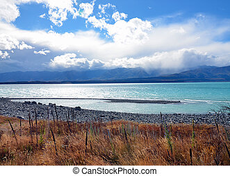 Lake Pukaki, New Zealand - Turquoise colored lake with...