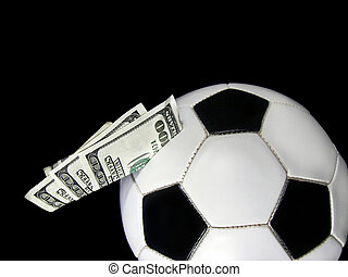 Betting On The Game - Money in a soccer ball.