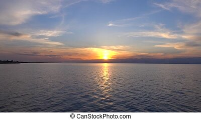 Beautiful sunset over Issyk Kul lake in Kyrgyzstan and ridge...