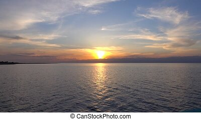 Beautiful sunset over Issyk Kul lake in Kyrgyzstan and distant ridge line 4K