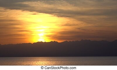 Beautiful sunset over Issyk Kul lake in Kyrgyzstan and...