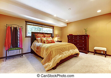 Single woman asian master beddrom interior with yellow walls...