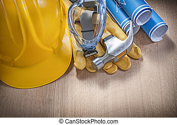 Protective work wear claw hammer rolled construction plans...