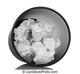 Waste basket with crumpled paper isolated on white...