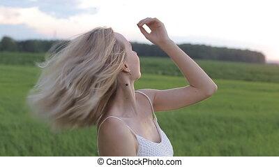 wearing white dress standing in a field.