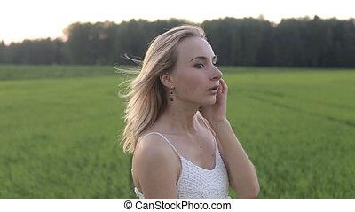 wearing white dress standing in a field
