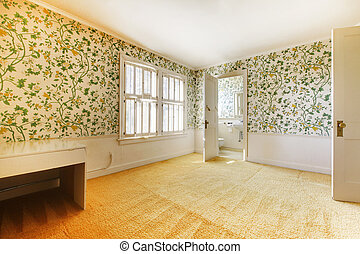 Adorable light bedroom with floral patterned wall paper and...