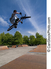 BMX Bike Stunt Table Top - Bmx Table Top on a skatepark.