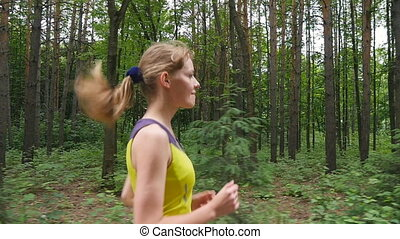 Girl running in forest trail