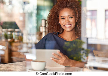 This cafe is a great place to hang out - Portrait of an...