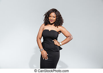 Happy afro american woman in fashion dress