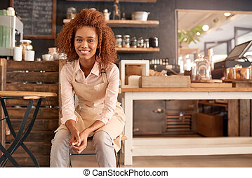 Taking a break from running the cafe - Portrait of an...