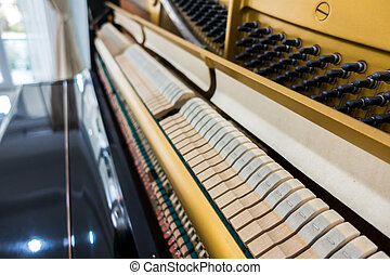Close up of Inside the piano with selective focus