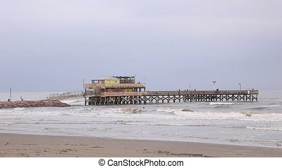 Fishing pier at the Gulf of Mexico Coast in Galveston Island...