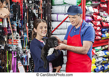 Happy Girl Buying French Bulldog From Salesman In Store -...