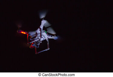Professional drone flying in the night.