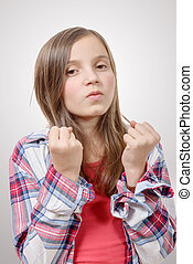 preteen girl in hipster style, angry isolated on grey...