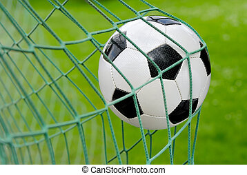 Soccer goal - Close-up of a soccer ball flying into the net