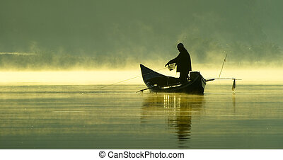 Fishing in the late evening on a boat.