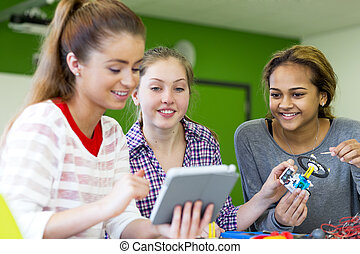 Teamwork in Lessons - Students working together with a...
