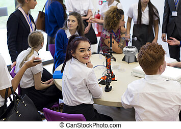 School Student Smiling at Camera During Lesson - teenage...