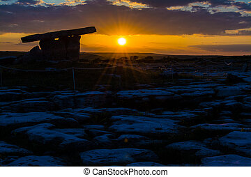5000 years old Polnabrone Dolmen in Burren, National Park Sunset Landscape, County. Clare - Ireland