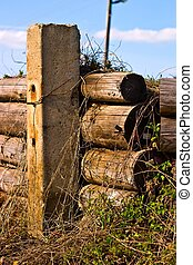 fence - Old wooden boundary fence with nails on sunny day