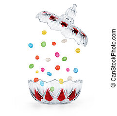Chocolates are falling into the clear candy on a white background