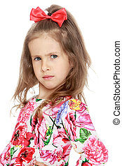Strict the little girl - Frowning a little girl with a red...