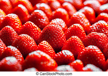 background from freshly harvested strawberries, directly...