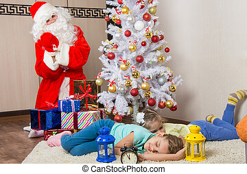 Santa Claus brought gifts for New Years Eve and softened faces of the two sleeping sisters