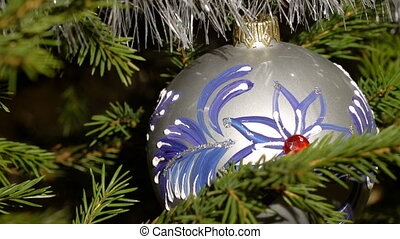 A nice christmas tree ornament - A zoom out on a nice blue...